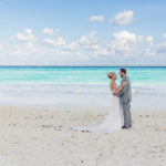 Bride and Groom portraits on the beach at the Hard Rock Cancun