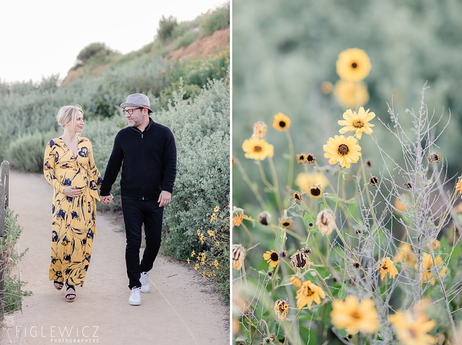 parents to be walking through yellow flowers at Terranea