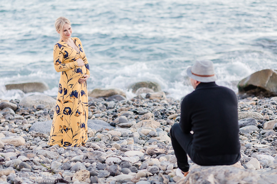 seaside maternity portraits with mom in yellow dress
