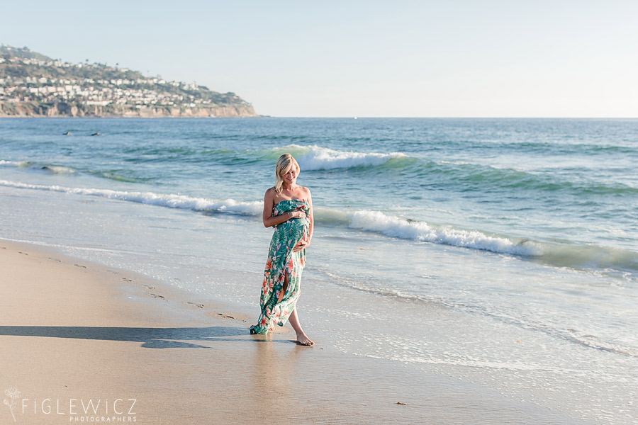 mother walking along beach with palos verdes in background