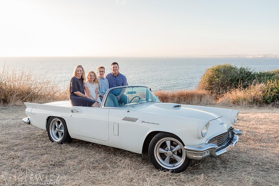 Family sitting in backseat of vintage car in Palos Verdes
