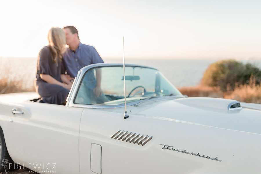 Couple kissing in car on cliffs of Palos Verdes