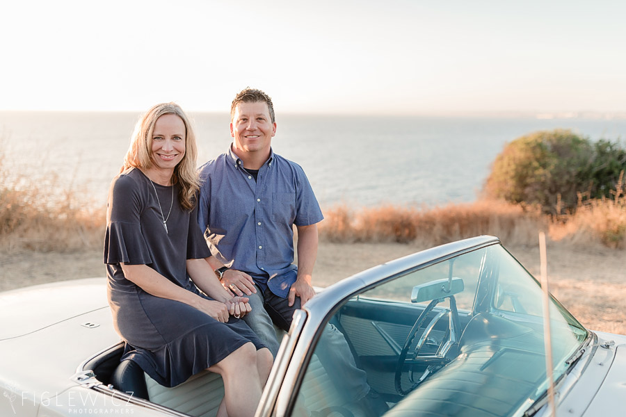 Couple smiling at camera in Ford Thunderbird during their Palos Verdes Engagement