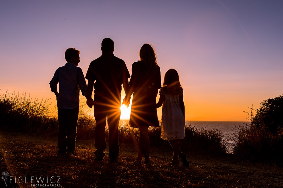 Family facing the coastal sunset for Palos Verdes Engagement