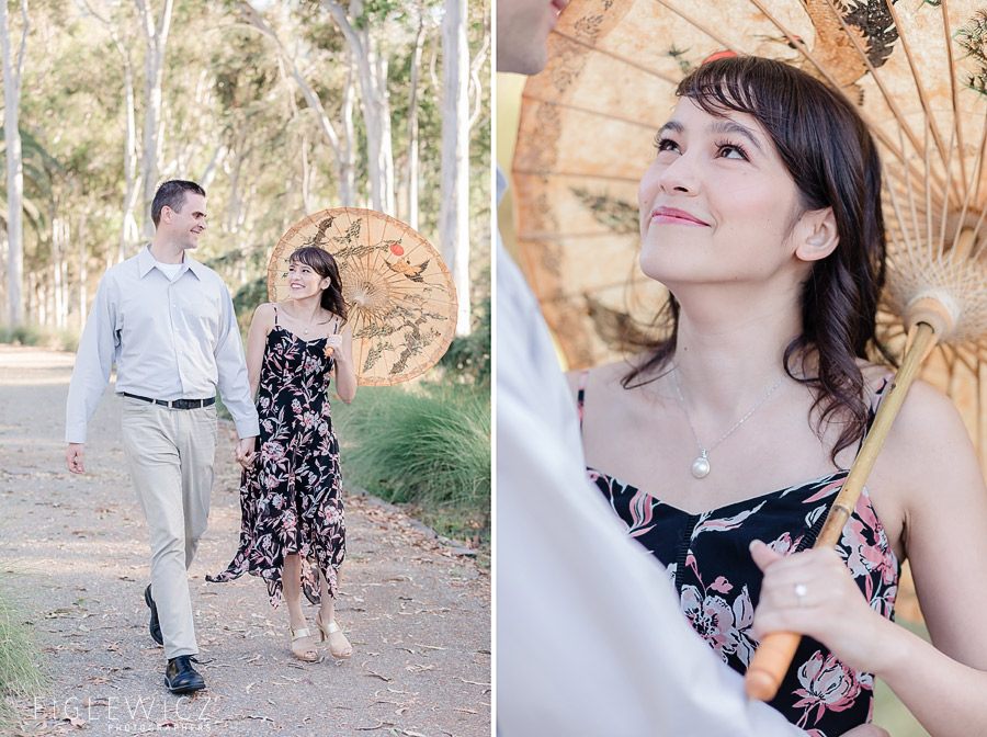 engaged couple strolling through palos verdes with parasol