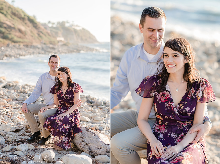 engaged couple sitting on palos verdes beach
