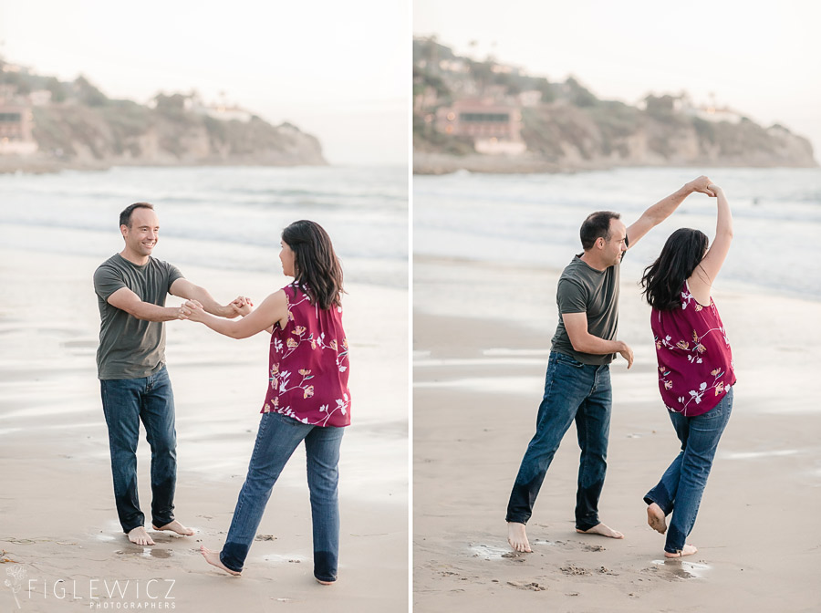 engaged couple dancing on beach