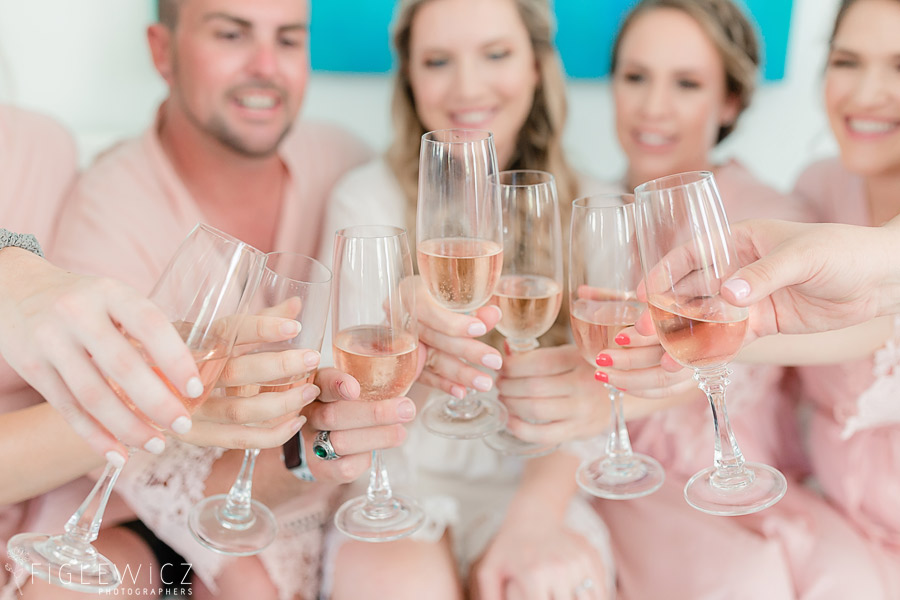 bride toasting champagne with wedding party