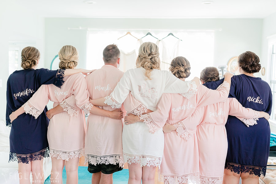 bride with wedding party in robes