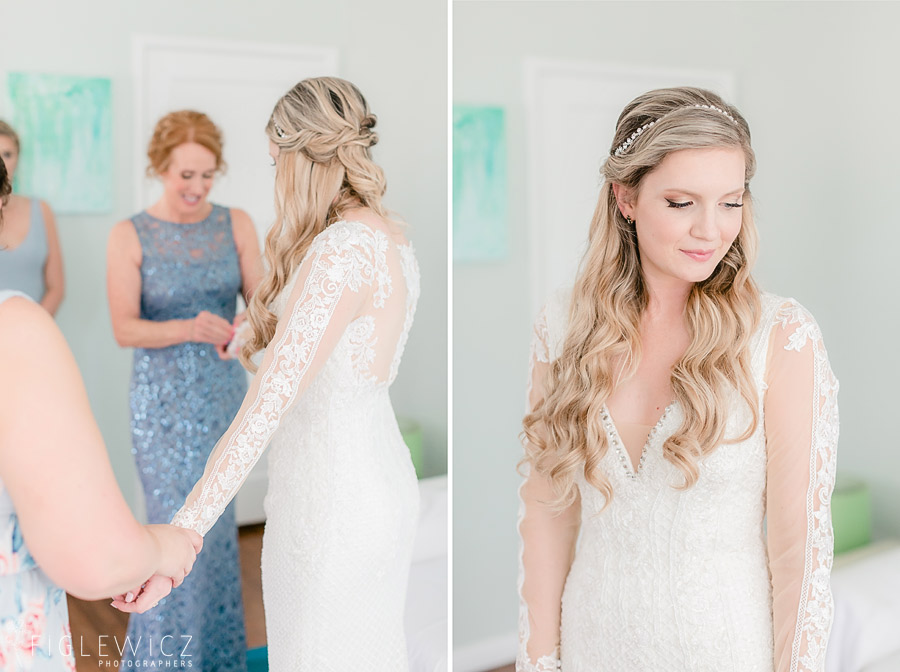 bride getting dressed in wedding gown