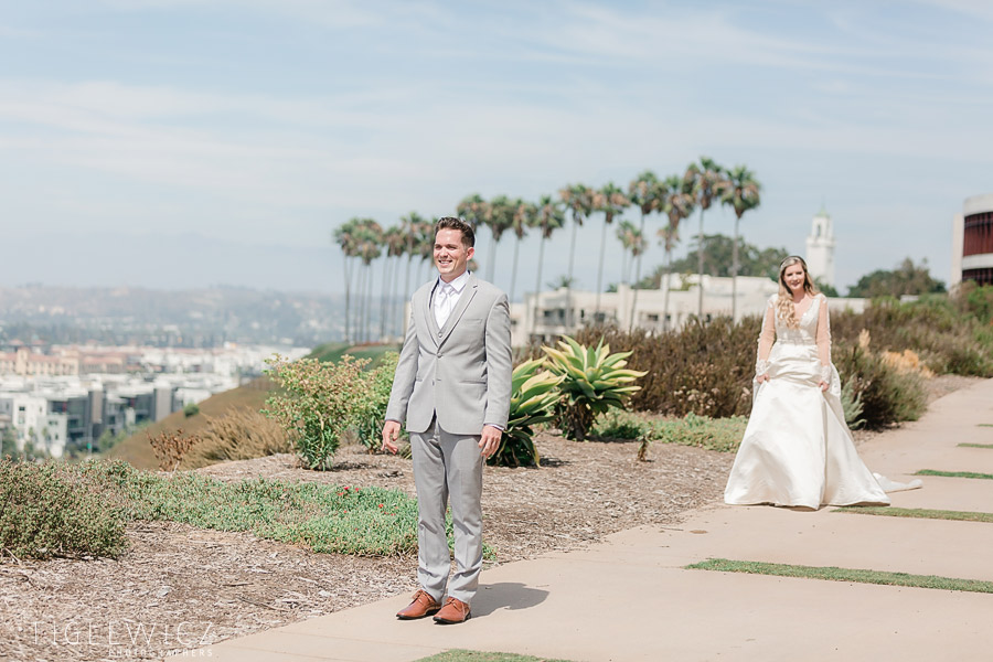 south coast bride walking toward groom for first look