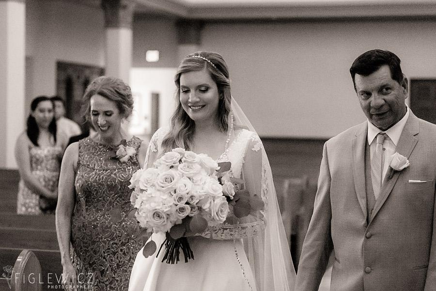 bride walking down aisle sacred heart wedding