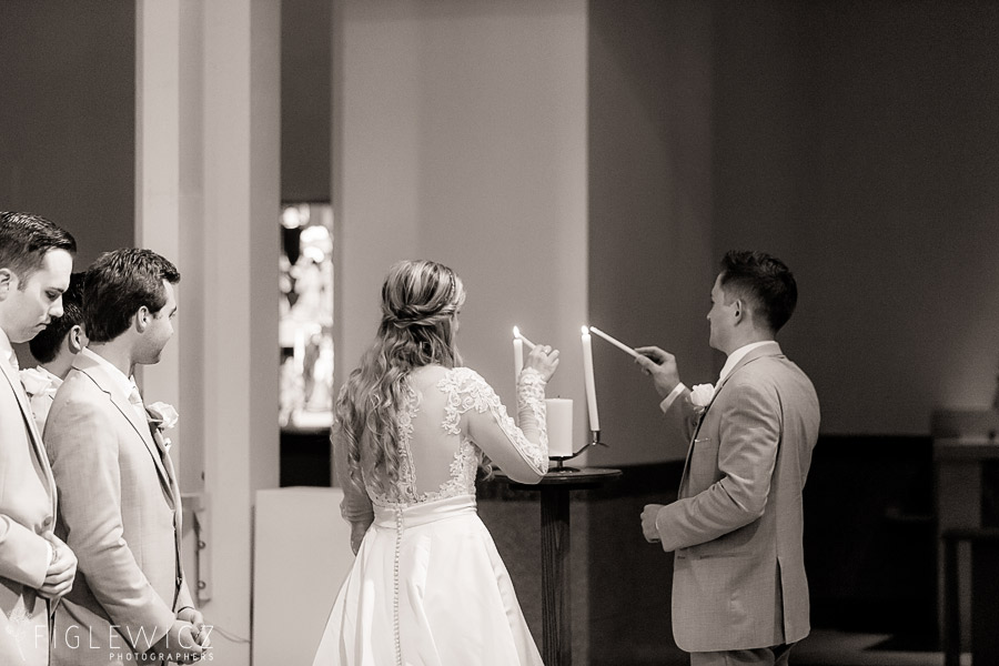 bride and groom lighting candle sacred heart chapel wedding
