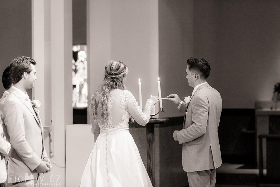 bride and groom lighting candle sacred heart chapel wedding