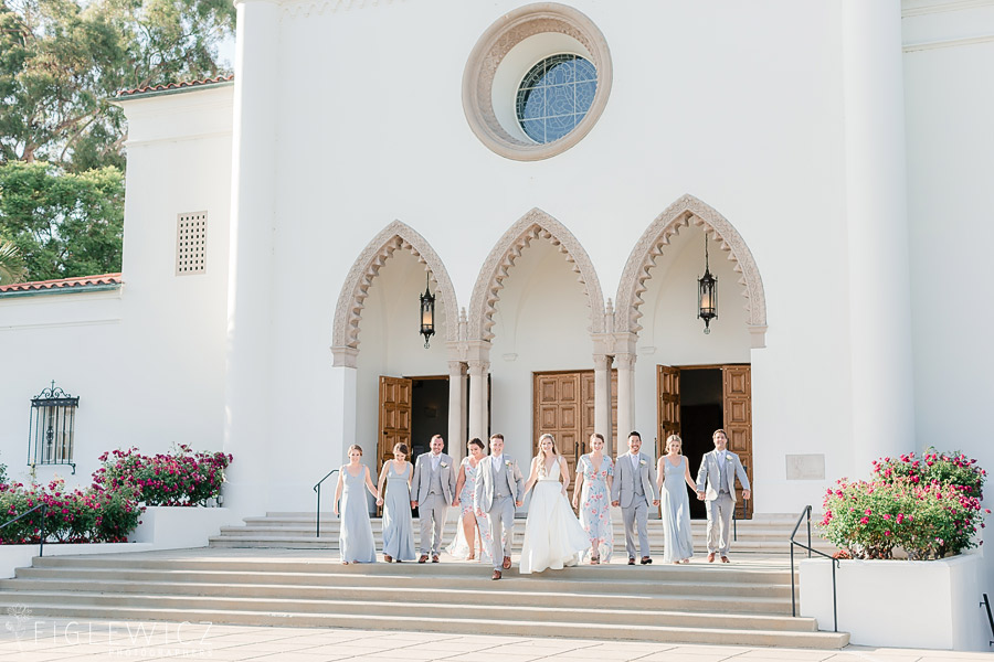 wedding party in front of sacred heart chapel