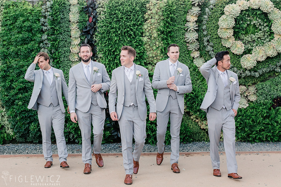 groomsmen in front of succulent wall at South Coast Botanic Gardens