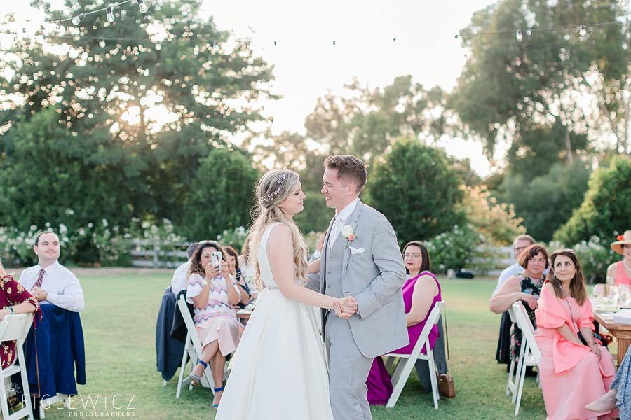 bride and groom first dance in garden wedding