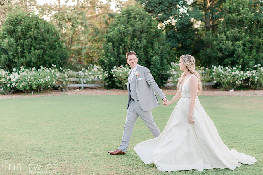 groom leading bride through south coast botanic gardens