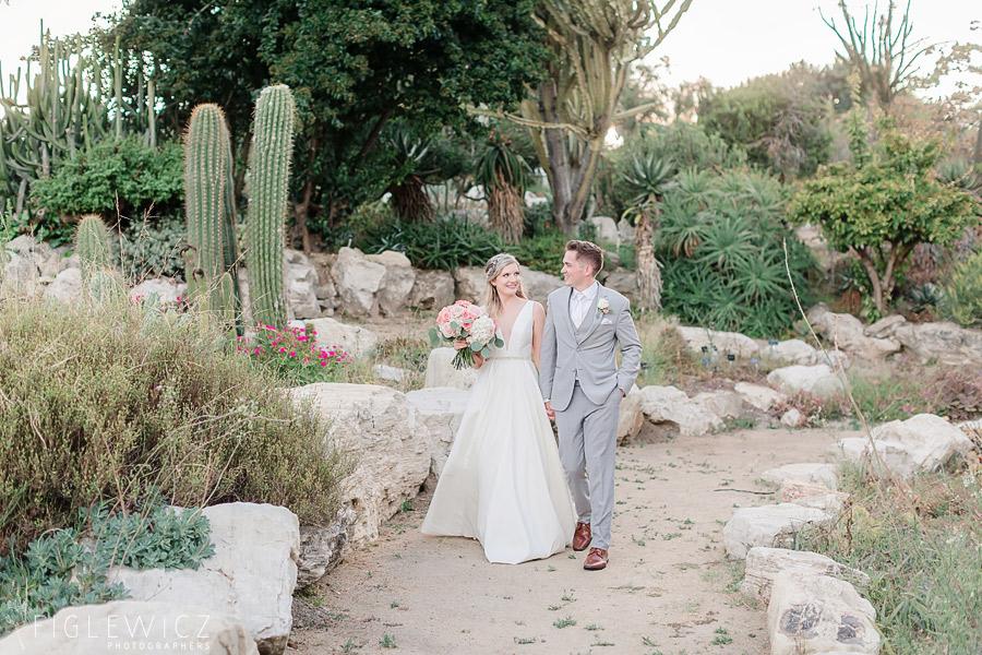 groom leading bride through south coast botanic gardens