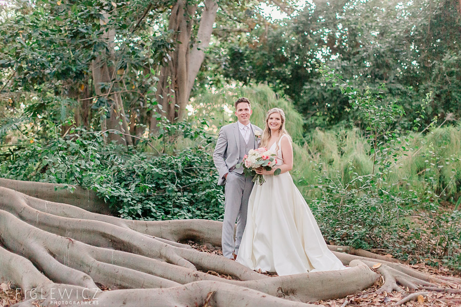 bride and groom standing in South Coast Botanic Gardens