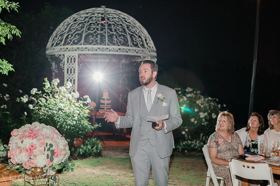 best man giving speech at garden reception